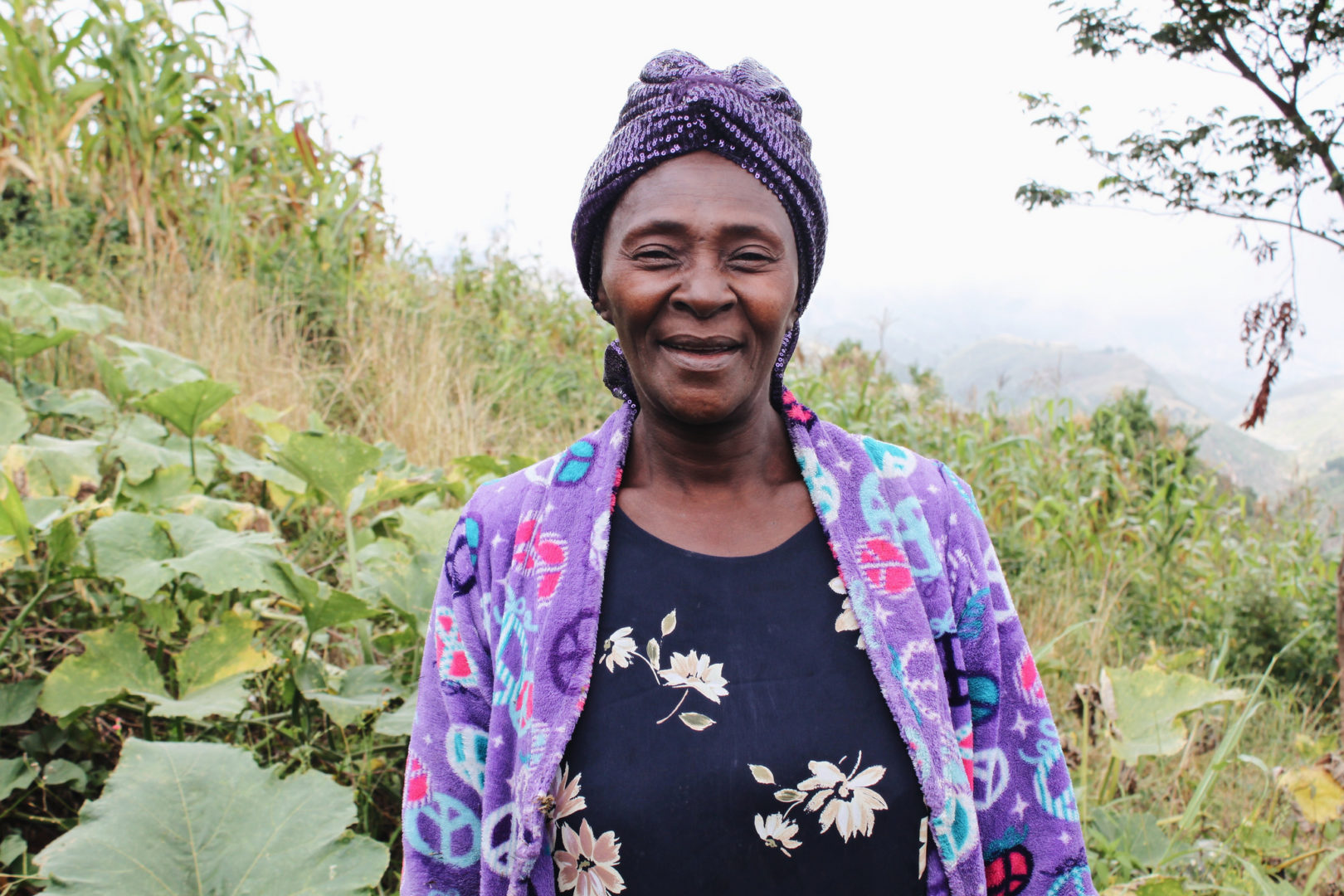 Dieula shares a smile from her farm in Haiti.