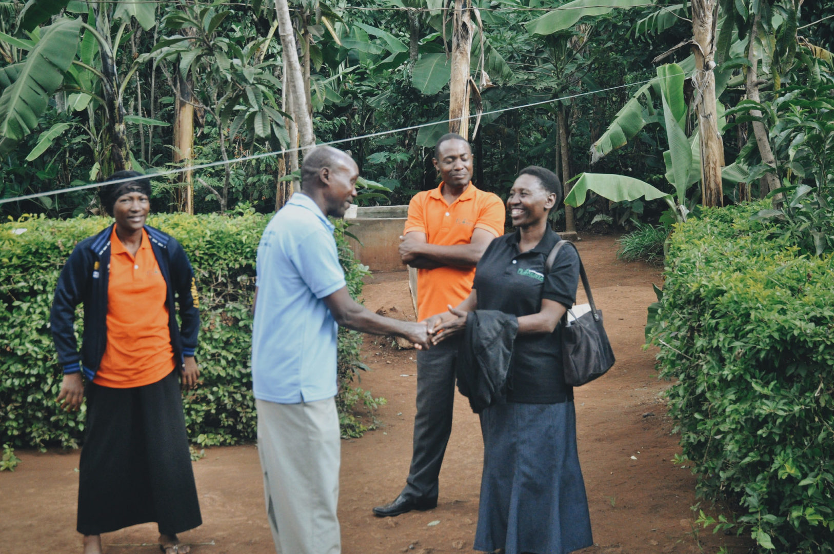 National staff members from Tanzania visit a program site in the country's rural areas.