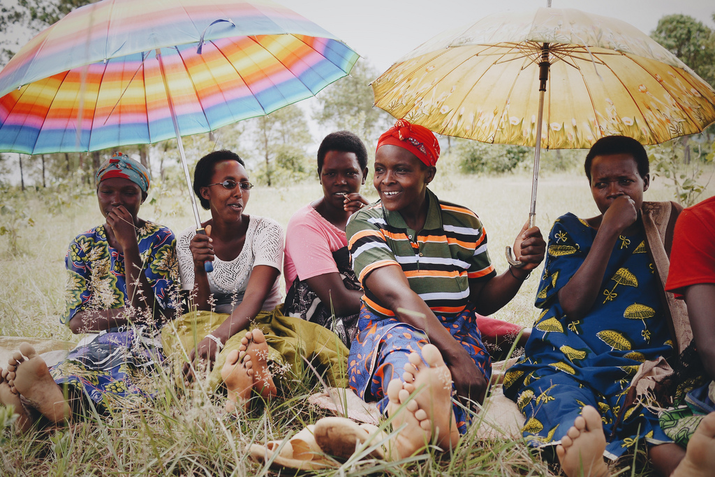 A group of women share smiles and shade in Burundi.