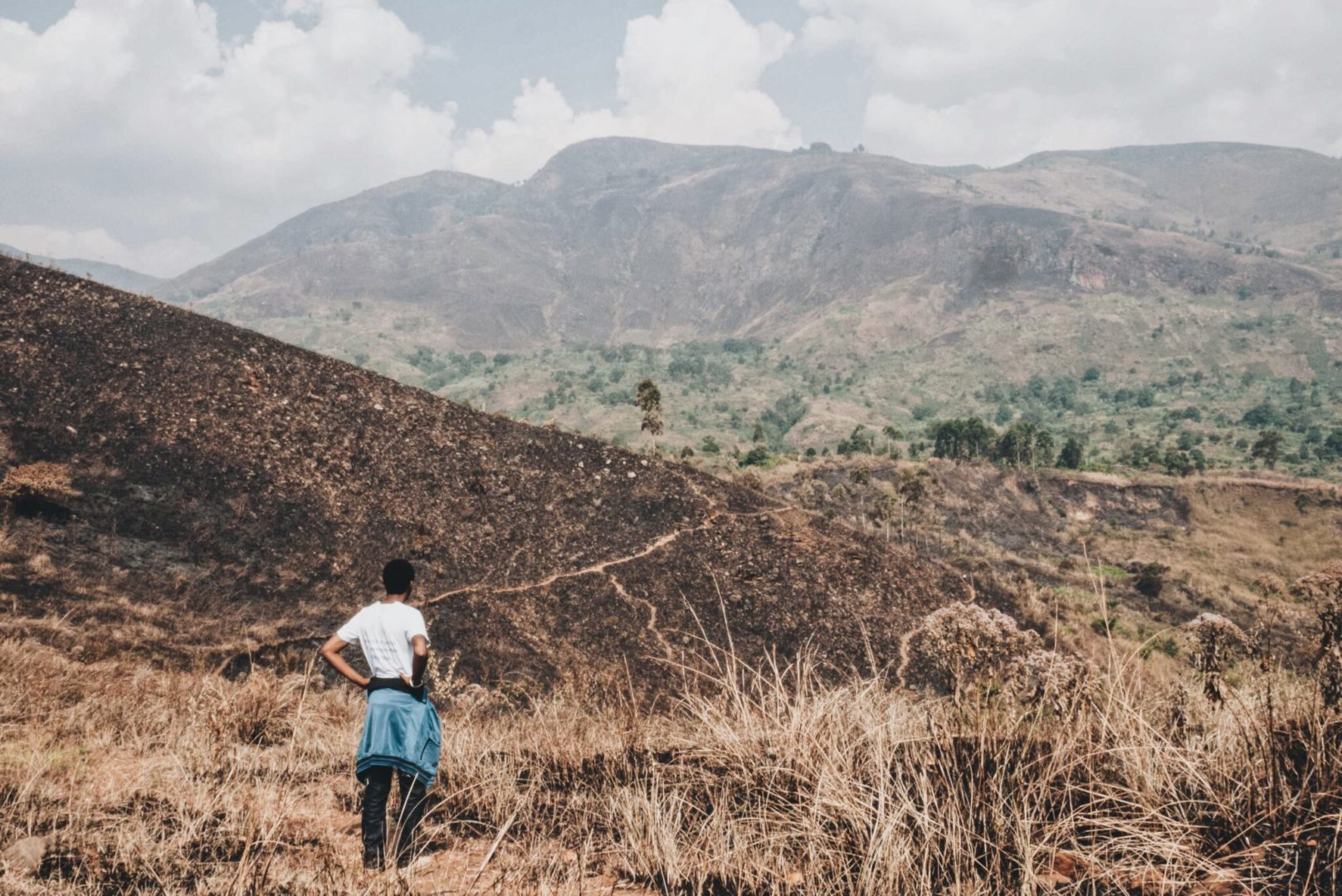 A Plant With Purpose staff member surveys watershed deforestation in the Democratic Republic of Congo. The lack of trees threaten its rural population's livelihood.