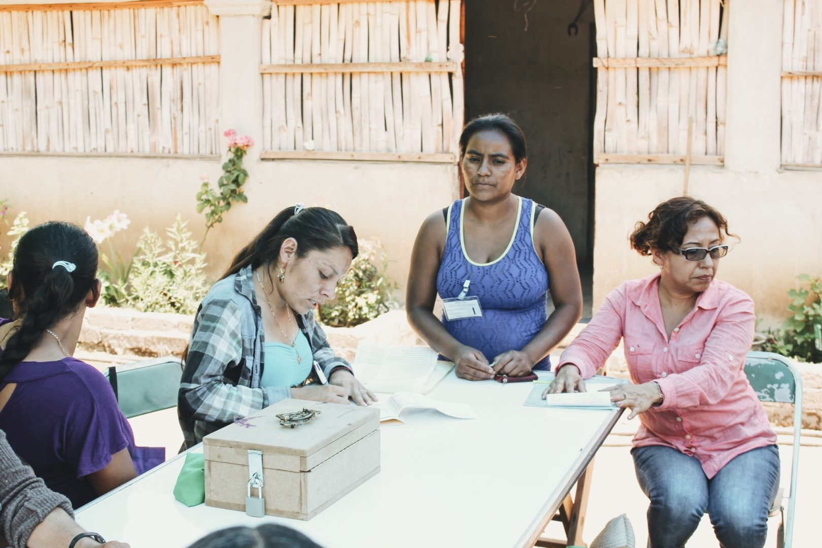 Juana meets with her community savings group.