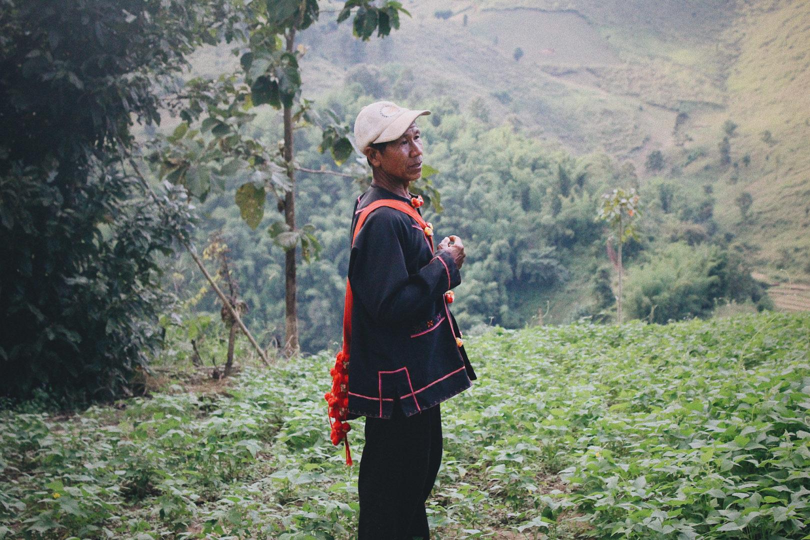 Jah Buh in his community's garden area.
