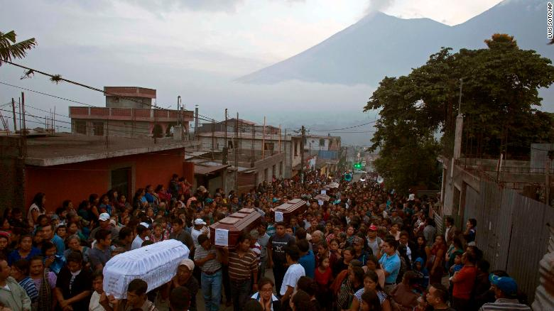 People carry the coffins of seven people who died during the eruption of  the Volcan de 8515b58faf