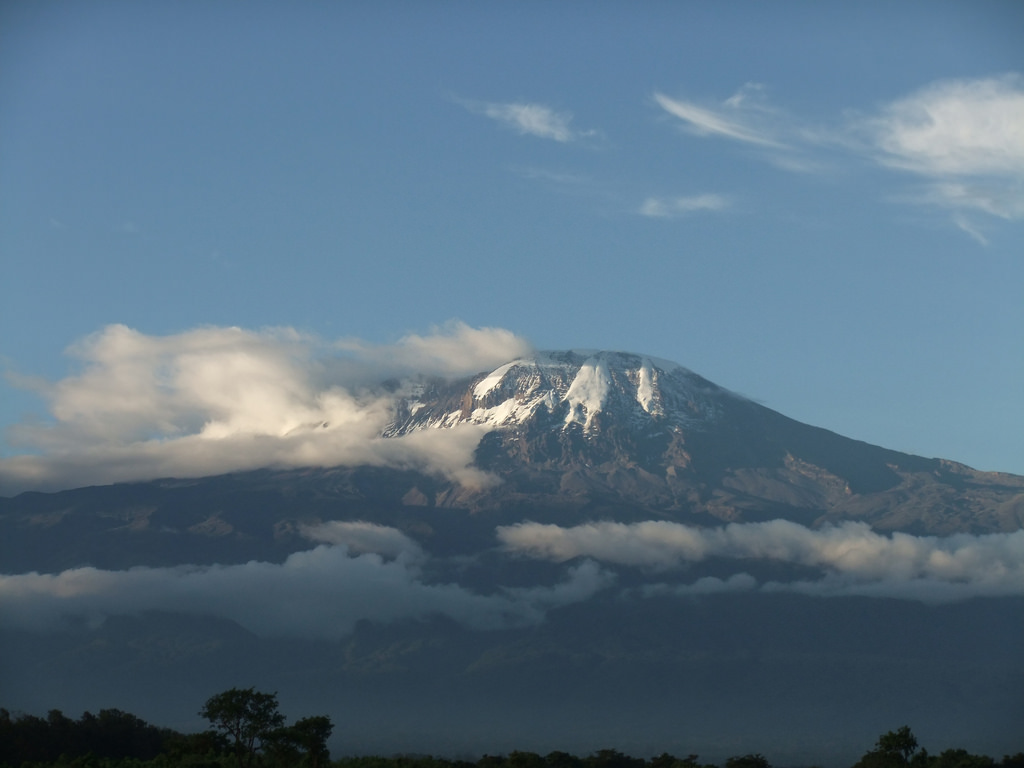 Kilimanjaro rises over Tanzanian farms.