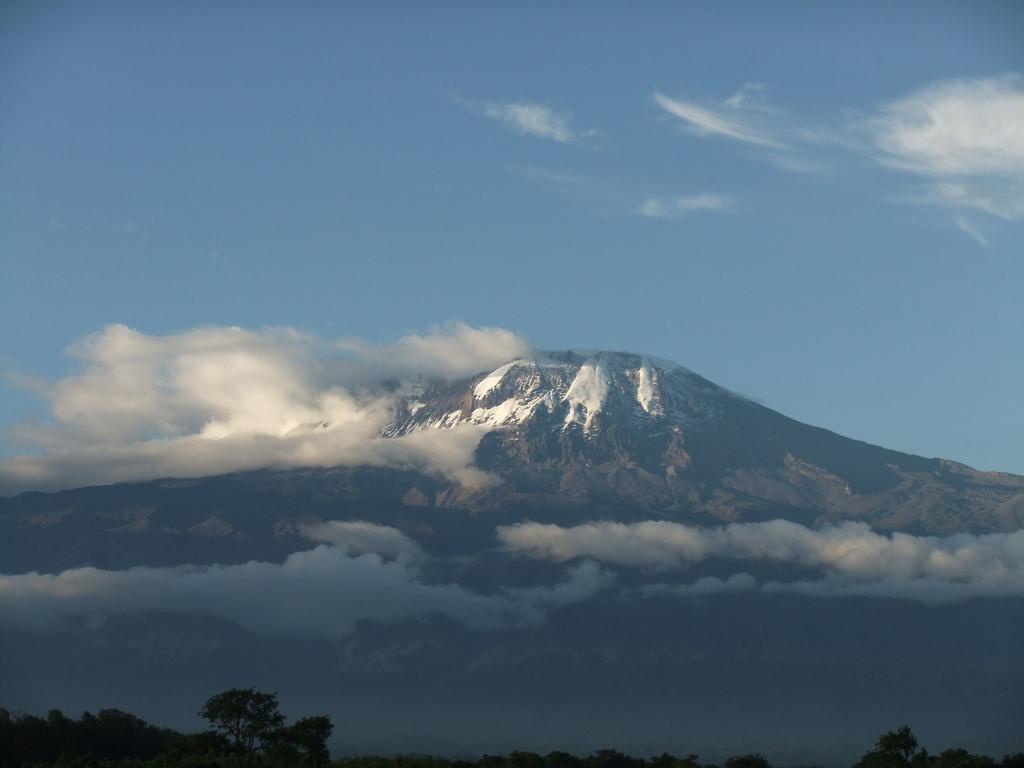 Kilimanjaro rises over Tanzanian farms.