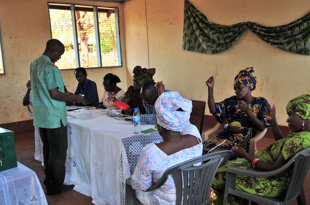 A savings group meeting in a house in Tanzania.