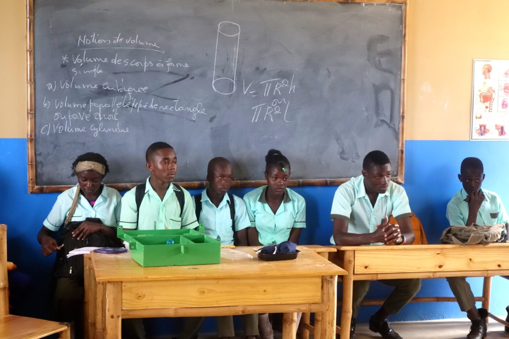 Middle schoolers at a group meeting in Haiti