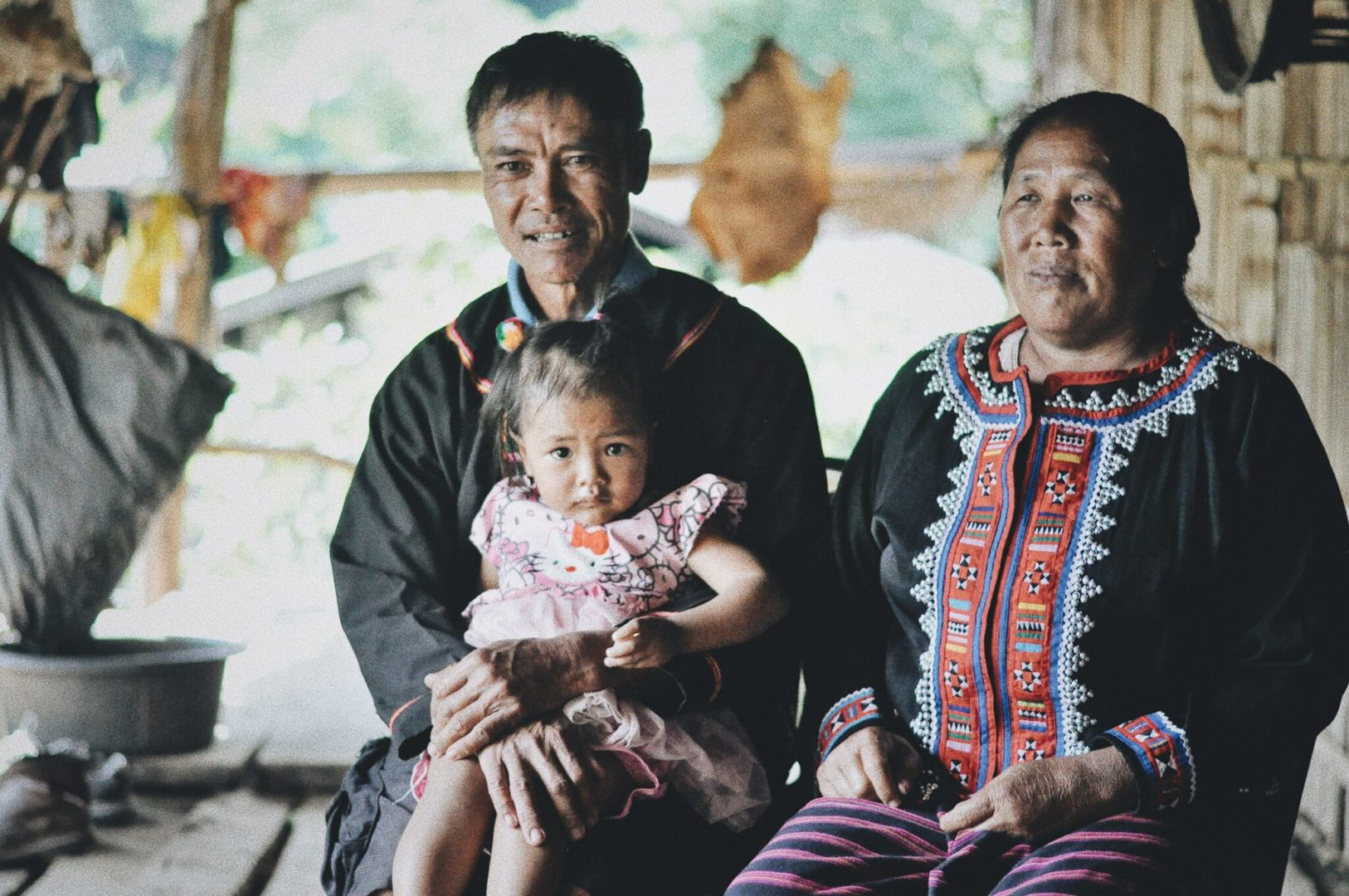 Bok Chee helps provide care for his granddaughter